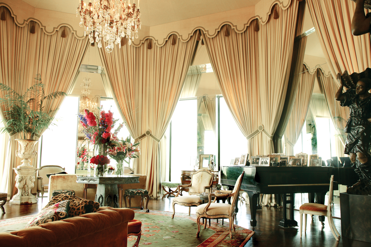 A PENTHOUSE VIEW: This grand piano is one of two in Nancy Hamon's vast living room, and both get played often. The octagonally shaped space has an almost 360-degree view of Turtle Creek below and many cozy sitting areas, making it ideal for parties. The Aubusson rug, which Mrs. Hamon bought at a Sotheby's auction, is a rare octagonal shape.