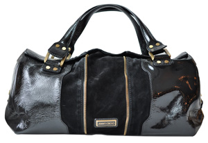 """""""My favorite big bag. It's good for travel and it zips into a mini."""""""