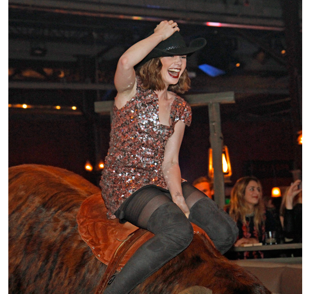 Lily Collins in Chanel atop the mechanical bull