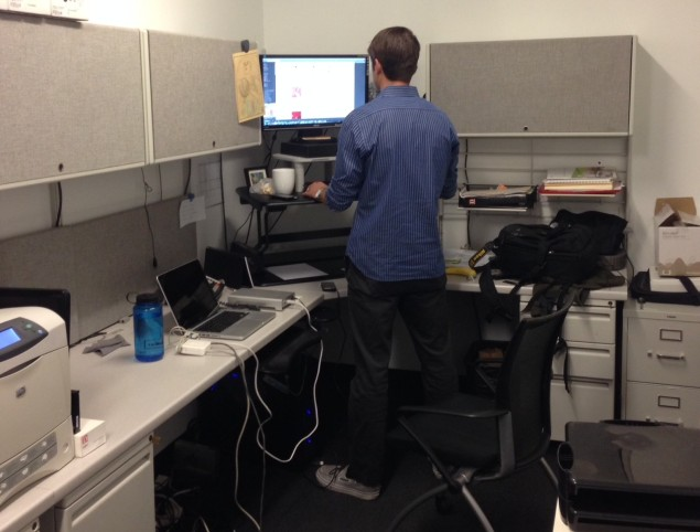 Matthew Shelley standing at his Varidesk, feeling strong and robust