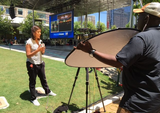 This poor Telemundo reporter. Not only did she have to endure the direct sunlight, but a dude was reflecting even MORE heat on her.
