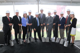 Developer Craig Hall, center, flanked by city officials and others associated with the new building.