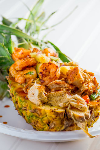 Alade's creation—marinated grilled chicken and shrimp served over a bed of yellow rice in half of a pineapple—is a rarity in the contest, since it isn't fried.