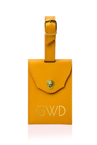A camel leather luggage tag from Bell'INVITO's new home collection.