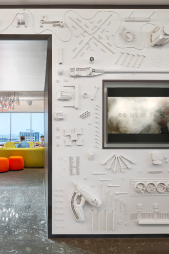 Manufacturing company Hilti embedded its own tools in a wall at its North American headquarters in Plano, turning its business into an art piece.