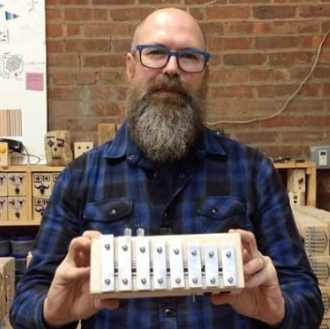 Richard Upchurch with the new Phone-Home xylophone, now made in Dallas.