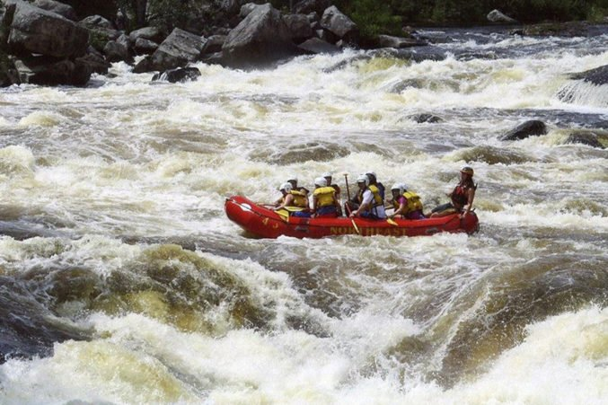 Debra von Storch white-water rafts with her family in Maine. Top right: von Storch with her son and husband on a hike in Peru.