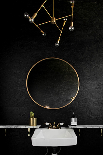 Steal this idea! We love how gloss-painted particle board takes on a luxe texture. Add gold and marble accents to complete the look.