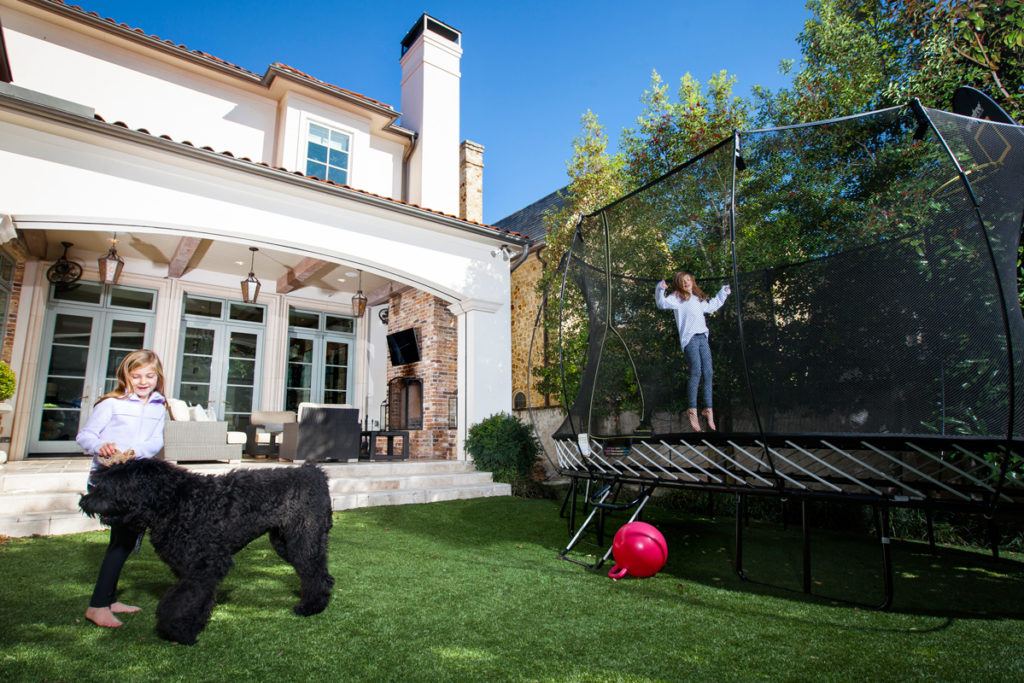 Cameron loves to recruit her sisters to jump on the trampoline with her after school. Their 10-month-old dog Dylan is even tempted to get in on the action.
