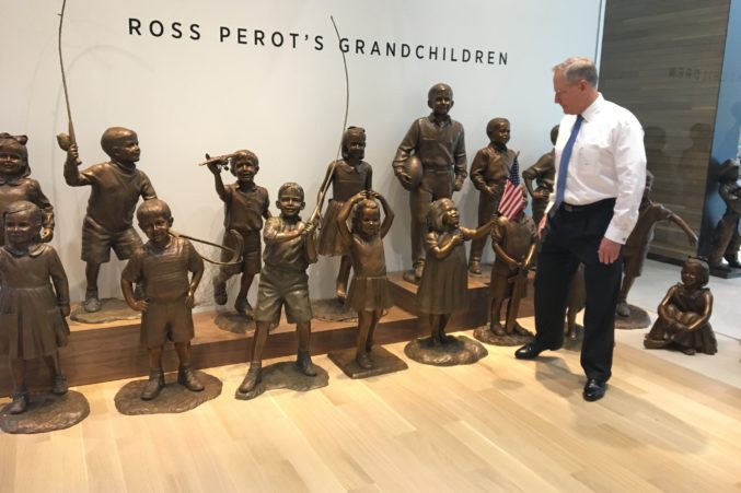 Ross Perot Jr. stands near a statue of his father's 16 grandchildren displayed at the Turtle Creek campus.