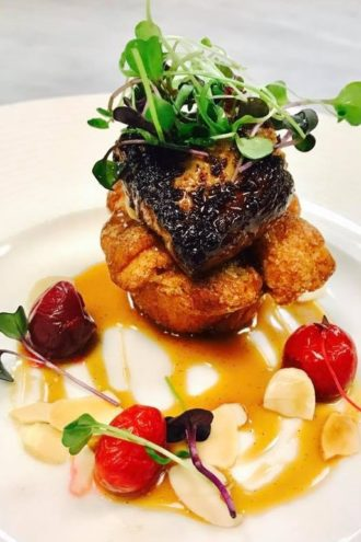 Seared Hudson Valley foie gras with cinnamon monkey bread, hickory-smoked butterscotch, almonds and cherries.