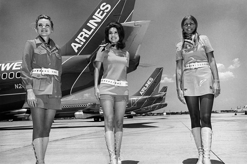 "In the late 1960s, flight attendants—known as ""stewardesses"" then—wore go-go boots, hot pants, and miniskirts."