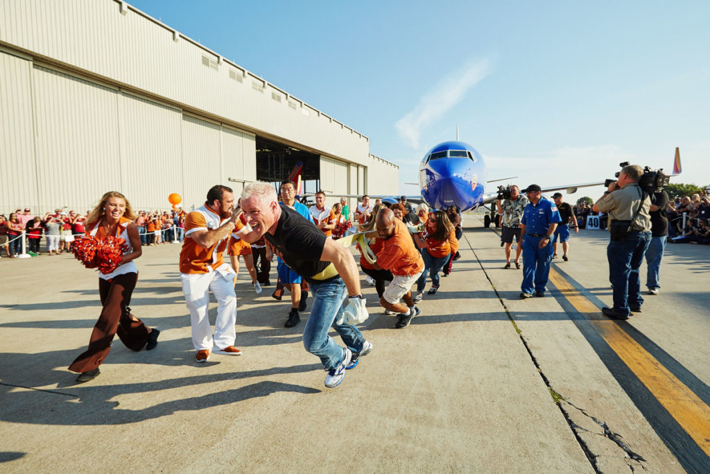 Employees had fun at the Southwest Airlines Pigskin Plane Pull, which celebrated the 2015 Texas-OU football game. Image courtesy of Southwest Airlines.