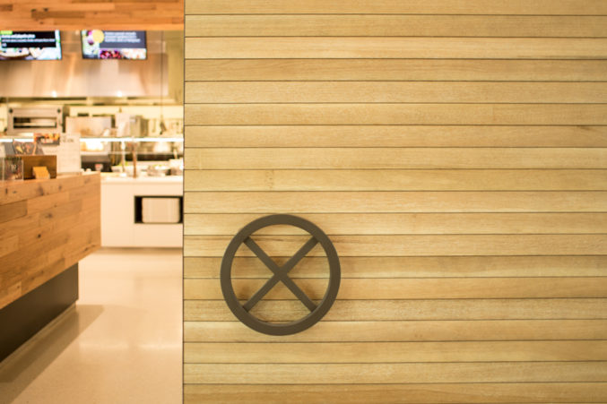 """The """"X"""" on the door to the cafeteria at the Perot Co.'s headquarters has a significance to the family that dates back nearly a century. (Photo: Jessica Chen)"""