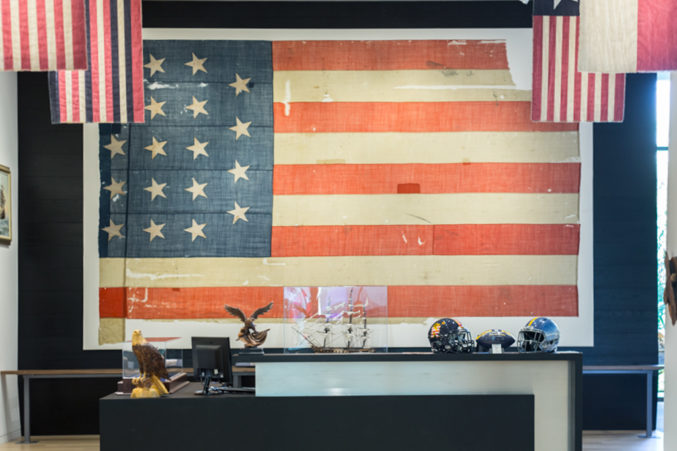 A flag from the original U.S.S. Constitution hangs at the new Perot Co. headquarters in Turtle Creek. (Photo: Jessica Chen)