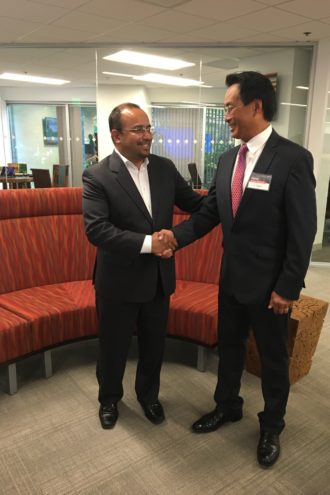 Marcos Jimenez, CEO of Softtek's U.S. and Canada operations, shakes the hand of newly elected Addison Mayor Joe Chow.