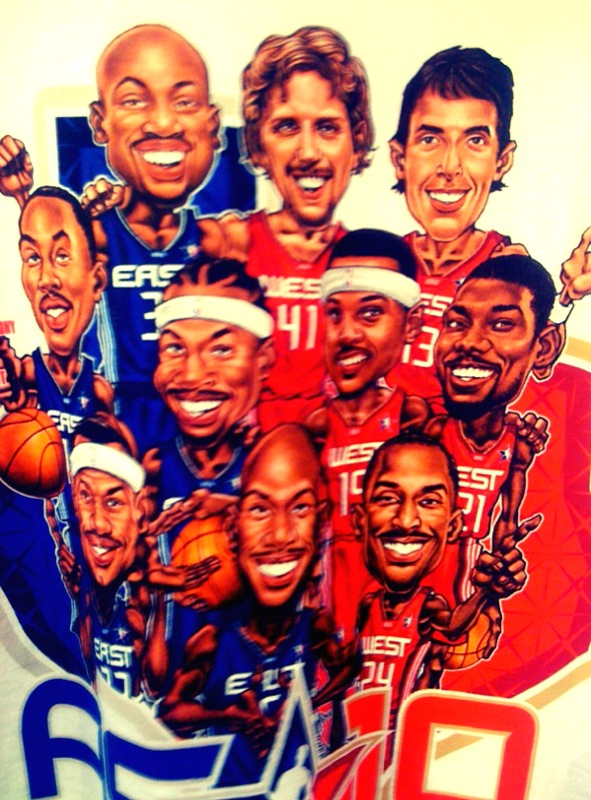 """I always love these caricature shirts. This, obviously, is the one for the All-Star Game. But when I saw it from about 20 feet away in the Adidas fan shop, I couldn't help but wonder, """"Weird that they put Pau Gasol on there instead of Dirk."""" And when I got closer, I wondered what Chris Rock was doing on it. (It was Tim Duncan.) Good shirt, but it bothers me that they have Dirk and Dwyane Wade with their arms around each other. I guess it's for the NBA fan who doesn't actually watch the NBA."""