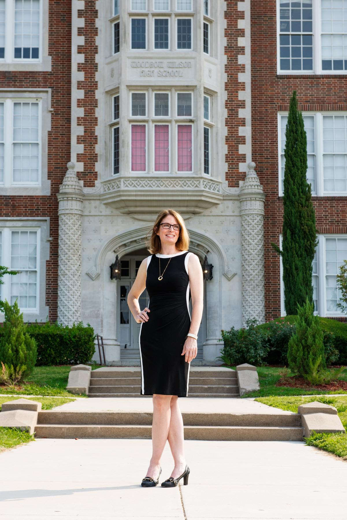 Lara Johnson, outside Woodrow Wilson High School, where she was once a student. (Photo by Jonathan Zizzo)