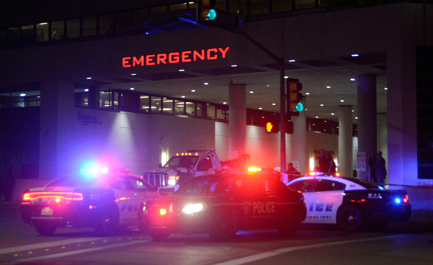Dallas Police cars in front of the Baylor University Medical Center in the early hours of July 8. (Photo: Mark Kaplan/Newscom)