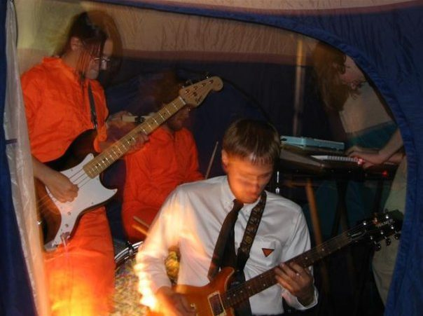Eat Avery's Bones playing in a tent in J&J's basement, 2006. Photo by Layla Blackshear.
