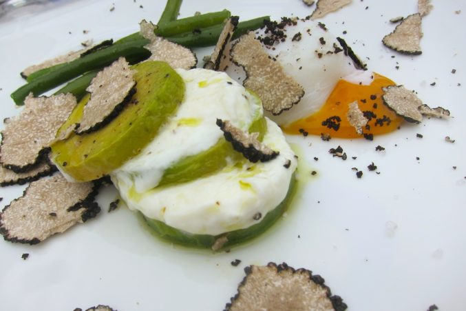 Avocado, scamorza and poached egg with black summer truffle at L'Assencio