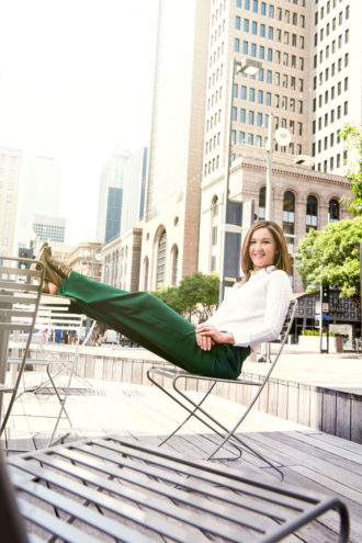 Kourtny Garrett leans back in downtown, which she hopes to make even more livable than it is.