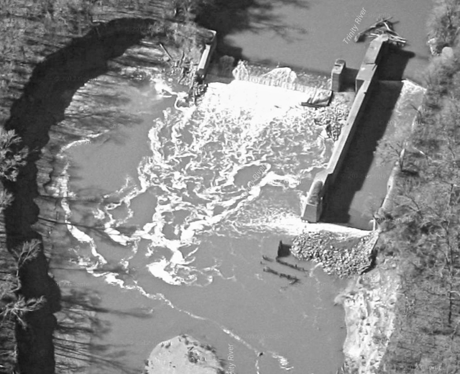 The lock and dam at Dowdy Ferry and South Belt Line roads. The lock is a concrete structure about 30 feet wide and 100 feet long where a barge would be chambered to raise or lower it. In present day, the locks are gateless chutes filled with water, debris and silt. (Photo: Google Maps)