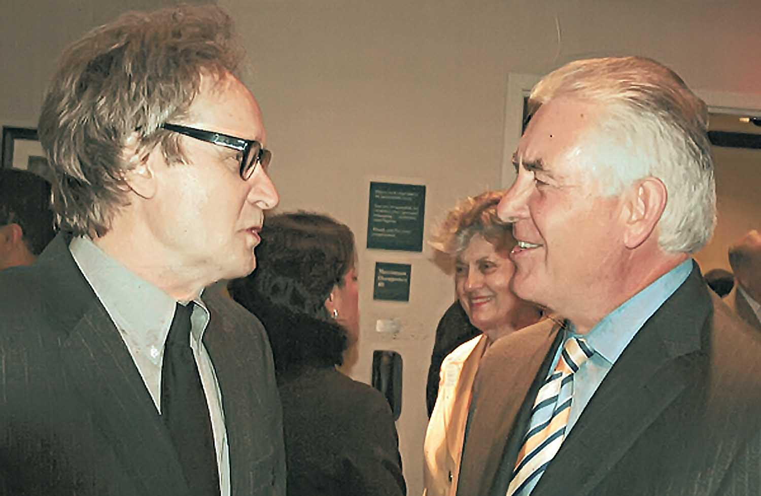 ExxonMobil Chairman and CEO Rex Tillerson (right), no doubt deflecting another of Glenn Hunter's annoying requests for an interview.