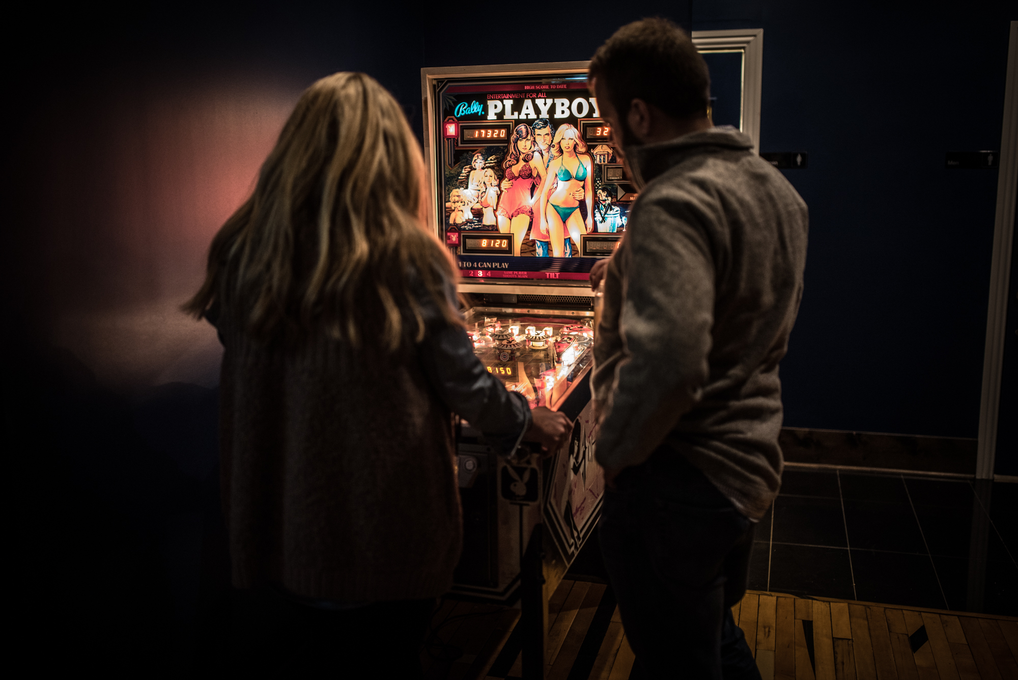 You'll find a Playboy pinball machine toward the back of the long, narrow bar.