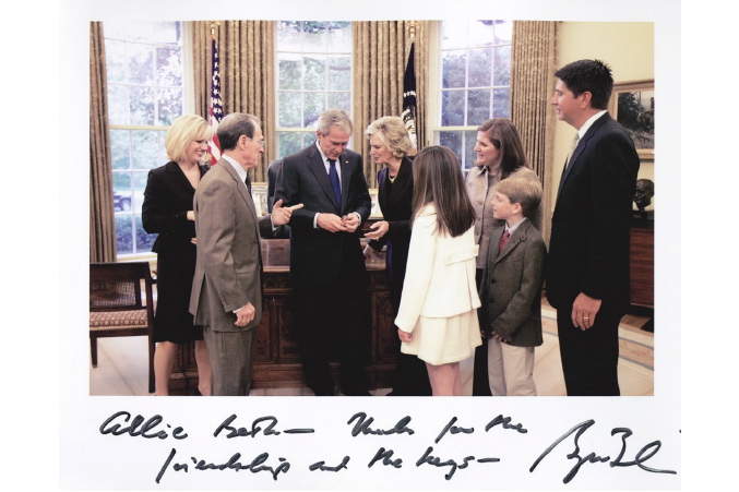 Allie Beth Allman hands then-President George W. Bush the keys to his new Preston Hollow home during a visit to the White House.