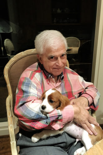 "A Real Mensch: Ira with Oliver, the family's Cavalier King Charles spaniel. ""If there was a time to lose Ira, it was not now,"" said Rabbi Adam Roffman at his funeral."