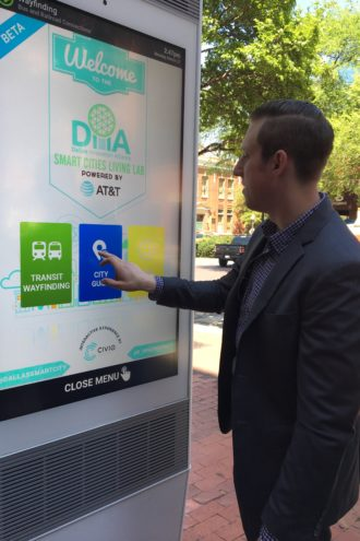 Josh Bergland of CIVIQ Smartscapes demonstrates the West End's new interactive kiosk, which offers visitors, maps, a selfie app, and information on local attractions and services.