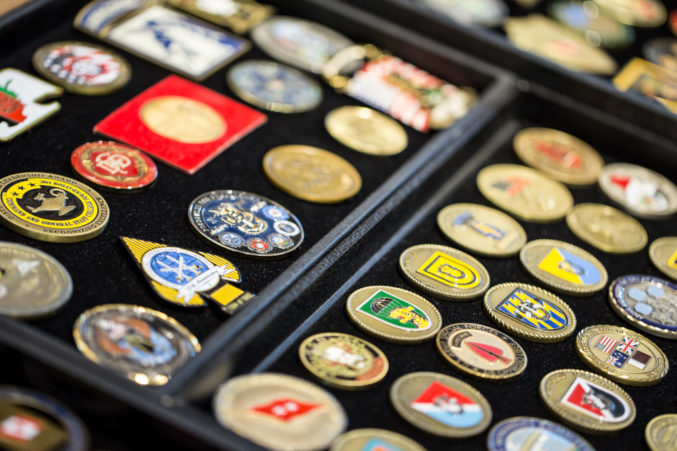Rows and rows of these coins line the outside of Ross Perot Sr.'s office, so many that you may be inclined to wonder if he is running out of room. (Photo: Jessica Chen)