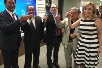 Esteemed guests celebrated the opening of Softtek's regional headquarters in Addison with a toast of tequila.
