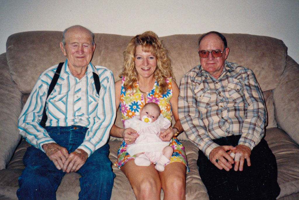 Harold sitting next to his daughter, Deb, and his granddaughter.
