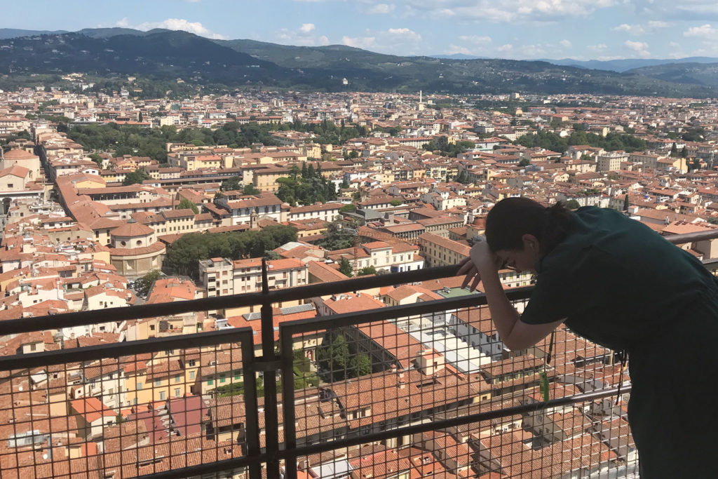 Krista leaning on a railing in Florence