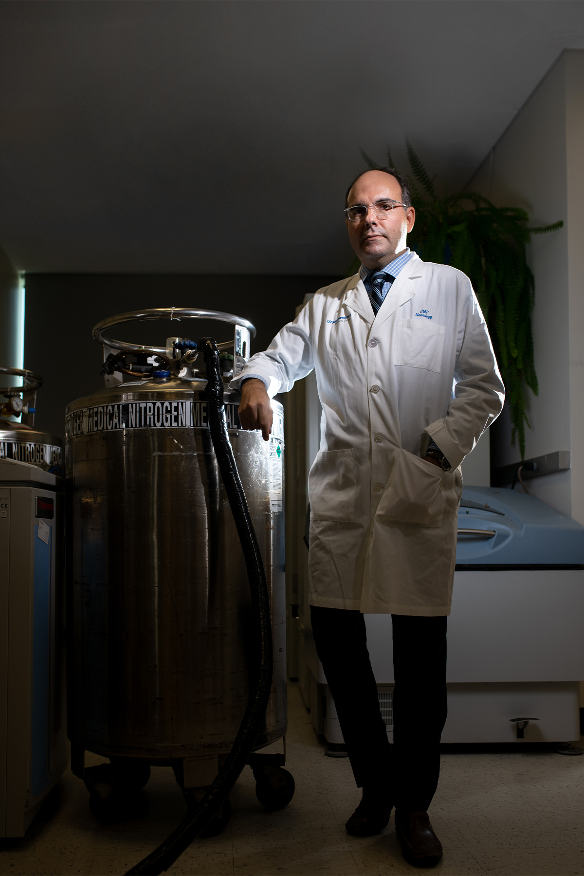 Dr. Pascual standing next to a nitrogen tank