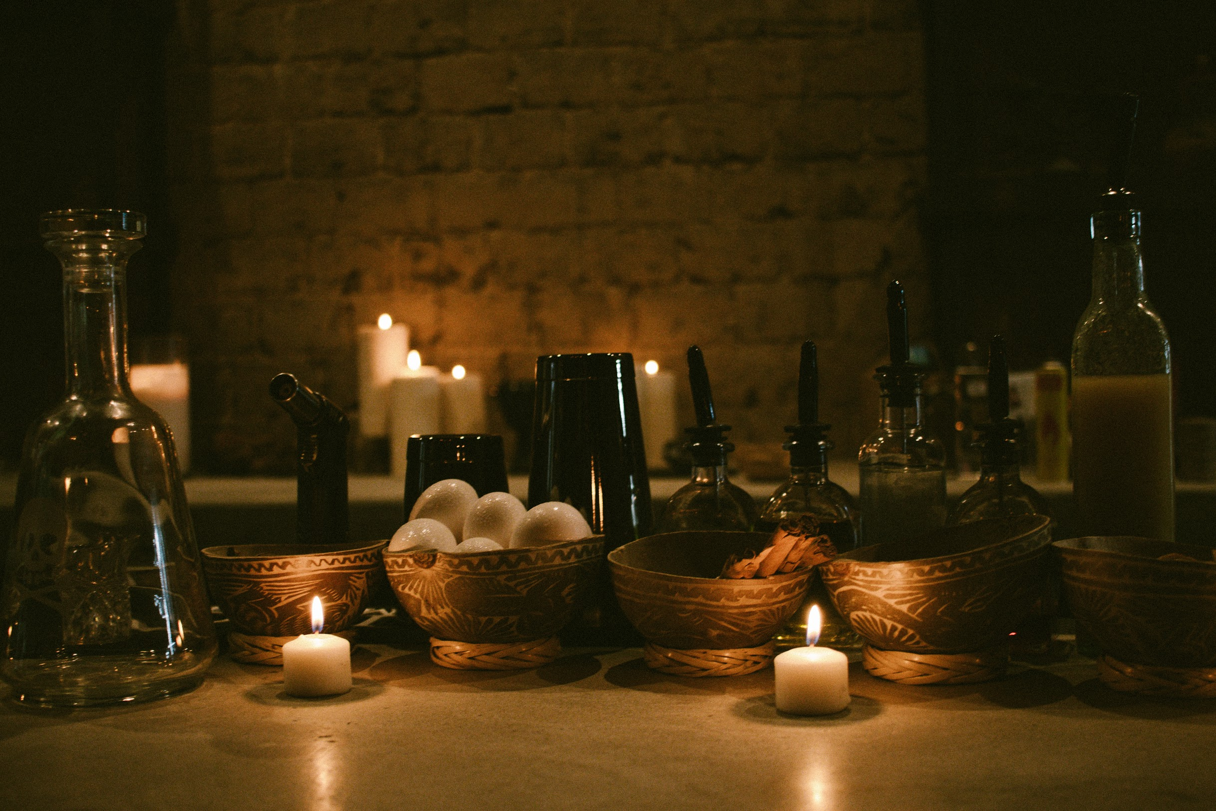 Candles on a bar at Ayahuasca Cantina.