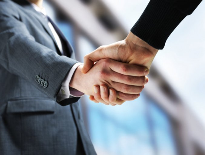 depositphotos 10654338 stock photo two businessmen shaking hands.
