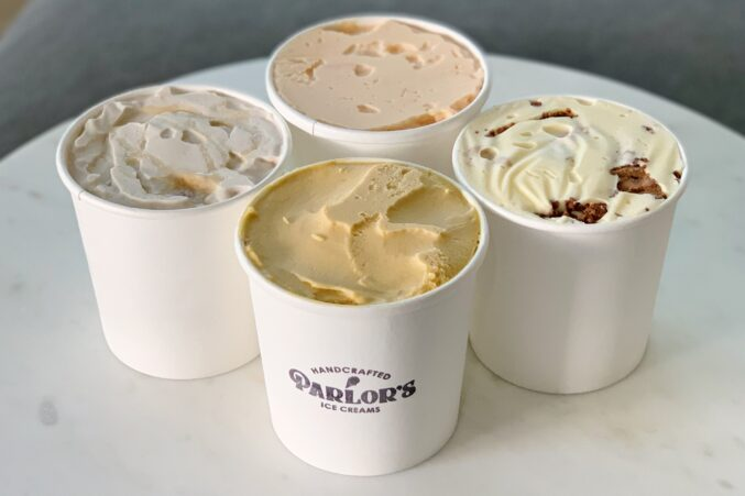 Four pints of Parlor's Ice Cream on a table.
