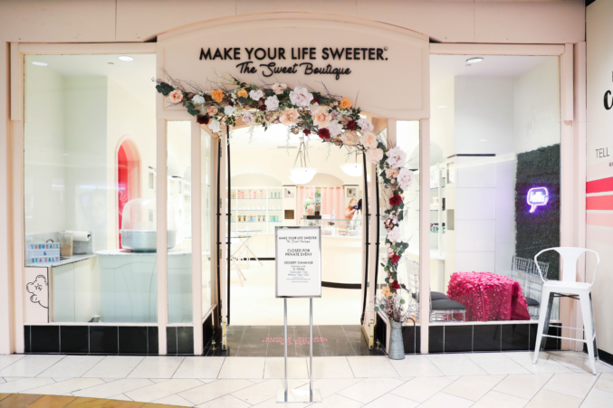 Make Your Life Sweeter The Sweet Boutique's paper flower entrance at the Dallas Galleria.