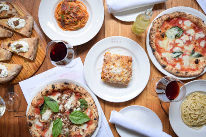 A table of pizza and pasta.