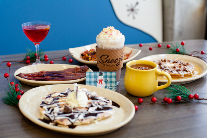 A table with pancakes, Christmas cocoas, and more.