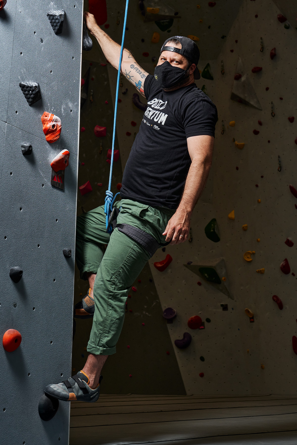 Chad Houser of Cafe Momentum rock climbing