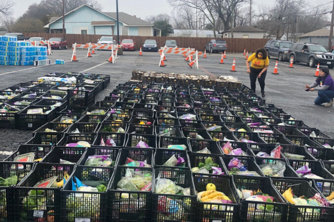 D2 Candidate Jennifer Cortez (left, in yellow) and Danaë Gutiérrez at a food distribution in Far East Dallas in February, shortly after the winter storms.