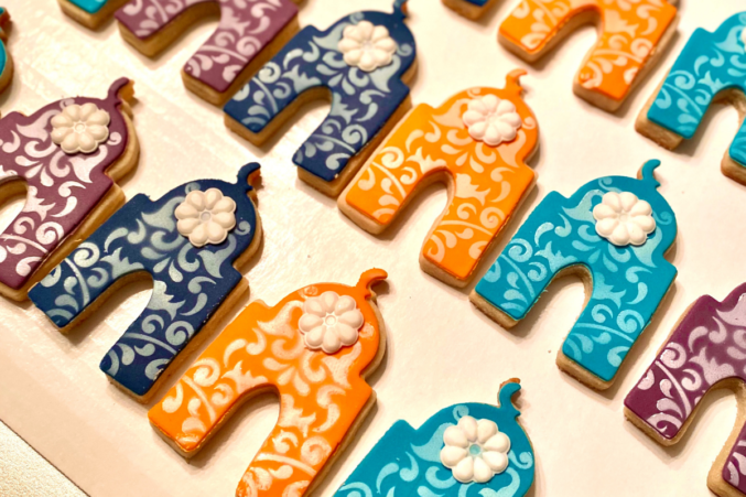 Mosque-shaped cookies in orange and teal, made by Plano-based homebaker Saadia Iqbal for Eid.