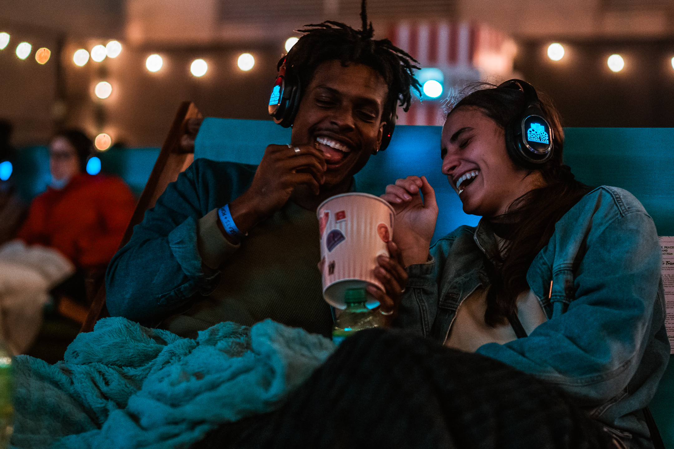 Guests laughing at Rooftop Cinema Club