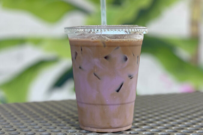 In a plastic cup: Vietnamese coffee with pink-hued hibiscus