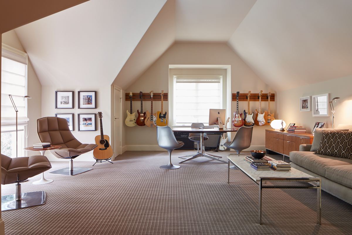Joels office is outfitted with an oval florence knoll rosewood table a trio of platinum eero saarinen tulip chairs and a vintage knoll credenza topped